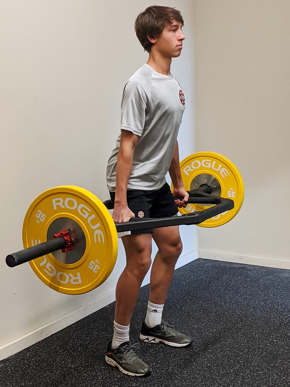 Young athlete practicing deadlift