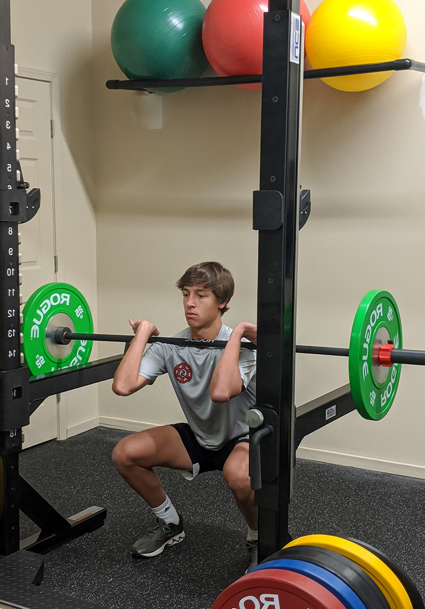 Squats with barbell on chest
